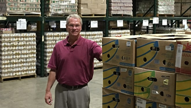 Tim Kean, president and CEO of Second Harvest, is shown in the food bank's warehouse north of Muncie.
