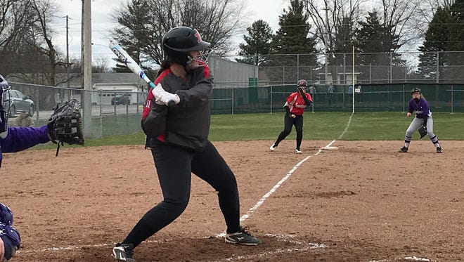 Pleasant's Grace Davis gets ready to swing at a pitch during a 12-2 win over Mount Gilead last week. Davis hit a home run and a double in the game.