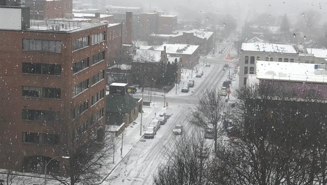 Downtown Burlington in the midst of Saturday, April 14, snowstorm expected to bring 2-4 inches by Sunday.