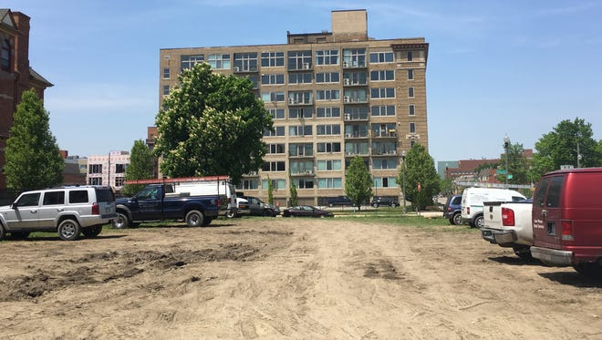 The dirt lot where a seven-story building is planned in Brush Park. Some condo owners in the Carlton Lofts building in the background fear the new structure will obscure their views of the Detroit skyline.