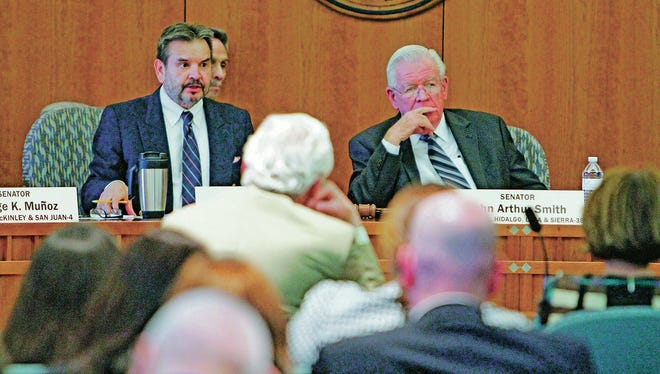From left, Sens. Carlos Cisneros, D-Questa, and John Arthur Smith, D-Deming, listen as David Abbey, director of the Legislative Finance Committee, speaks Wednesday about the state's new revenue outlook.