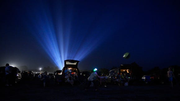 Parrotheads watch a pre-concert show before the livestreaming of a Jimmy Buffett concert in Texas on the big screen at Haar's Drive-In Theater in Dillsburg Thursday, June 19, 2014. Kate Penn -- Daily Record/Sunday News