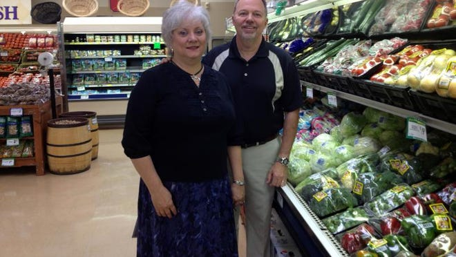 Terrie and Gary Baker of Baker's IGA at the Coshocton store that closed in 2018, in a Tribune file photo. The couple are selling their stores in Scio, Sugarcreek and Newcomerstown to Riesbeck's Food Markets.