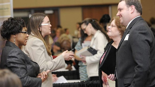 Sharon Lane of Speedway talks about employment possibilities at job fair at the Lansing Center.