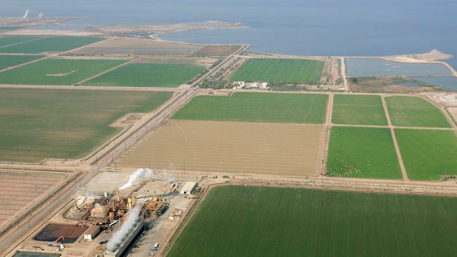 Imperial Valley farms and a geothermal power plant lie along the southern shore of the Salton Sea near Niland.
