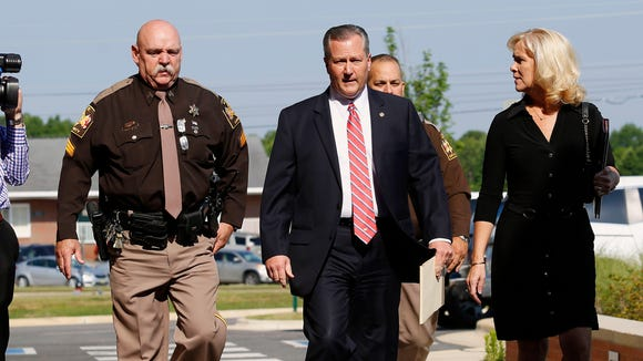 Mike Hubbard and wife Susan Hubbard walk to the Lee County Justice Center for day three of Hubbards trial trial on Thursday, May 26, 2016  in Opelika, Ala. Hubbard faces felony ethics charges accusing him of using his political positions to obtain $2.3 million in work and investments.  (Todd J. Van Emst/Opelika-Auburn News via AP, Pool)