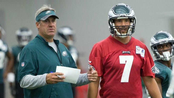 Eagles head coach Doug Pederson (right) said Friday he doesn't know yet how many snaps each quarterback will get in the Eagles' preseason opener Thursday.