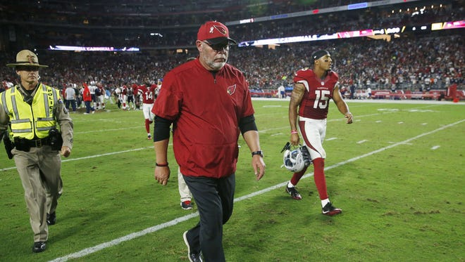 Arizona Cardinals head coach Bruce Arians walks off the field after losing the the New England Patriots 23-21 at University of Phoenix Stadium in Glendale, Ariz. September 11, 2016.