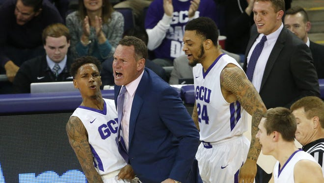 Grand Canyon University guard DeWayne Russell (0) celebrates with head coach Dan Majerle during a run against San Diego State in the second half at GCU Arena in Phoenix, Ariz. December 7, 2016.