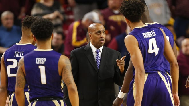 Washington head coach Lorenzo Romar talks to his team during a timeout against Arizona State during the second half at Wells Fargo Arena in Tempe, Ariz. January 25, 2017.