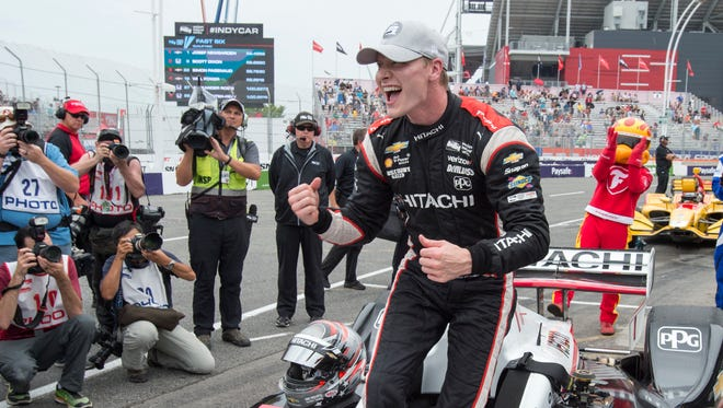 Josef Newgarden celebrates after posting the fastest time during qualifying for the IndyCar auto race in Toronto on Saturday, July 14, 2018. (Frank Gunn/The Canadian Press via AP)