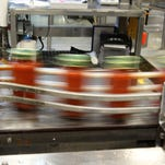 Jars of Newman's Own tomato sauce whiz by on a production line at a LiDestri Food and Drink facility in Rochester.