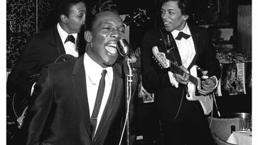 """Wilson Pickett performs with help from a young Jimi Hendrix on guitar in this photograph taken in 1966 by William """"PoPsie"""" Randolph."""