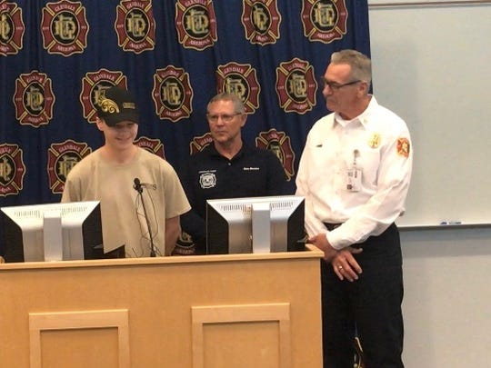 Logan Ahart (center) speaks about rescuing a Glendale man from his burning home on July 15, 2018.