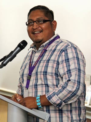 San Juan College student Julian Moses thanks PNM for a scholarship through the PNM Navajo Nation Workforce Training Initiative during a reception on Wednesday at San Juan College's School of Energy in Farmington.