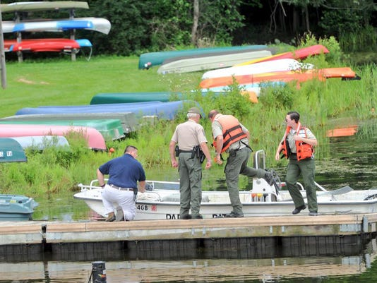 Emergency responders exit a boat at Pinchot Park.