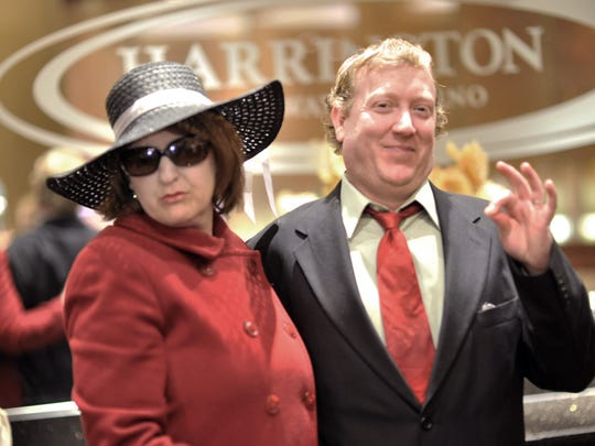 Brent Townsend and his wife, Kathy, of Bethany Beach, portray Melania and Donald Trump at the Harrington Raceway and Casino Player's Club invitation for guests to dress up as the president and first lady.