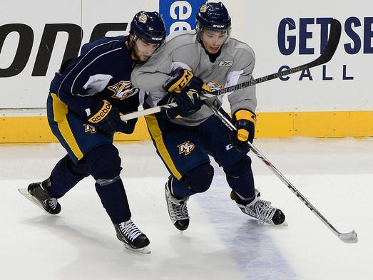 Predators prospect Zach Stepan, left, battles for the puck against Kevin Fiala during the development camp scrimmage Saturday at Bridgestone Arena.