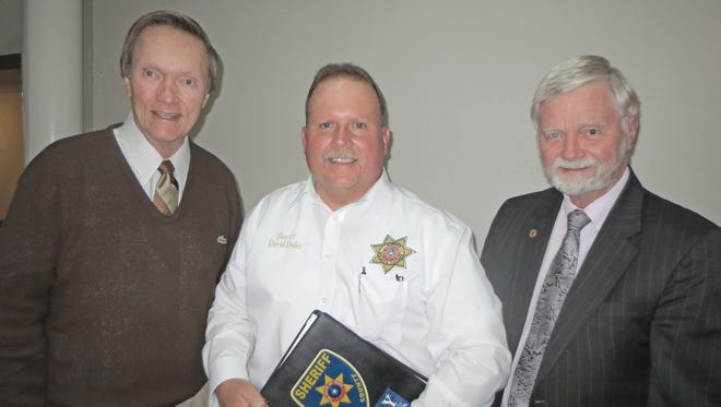 Visiting after the June meeting of the League of Women Voters are member Tom Merritt, speaker Sheriff David Duke and member Judge Woody Gossom. Duke spoke about mental health issues and their impact on his department. The local league is involved in a study of mental health issues in Wichita County.