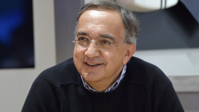 Fiat-Chrysler chief executive officer Sergio Marchionne attends a press conference at the Paris Auto Show in Paris on Oct. 2, 2014 on the first of the two press days.