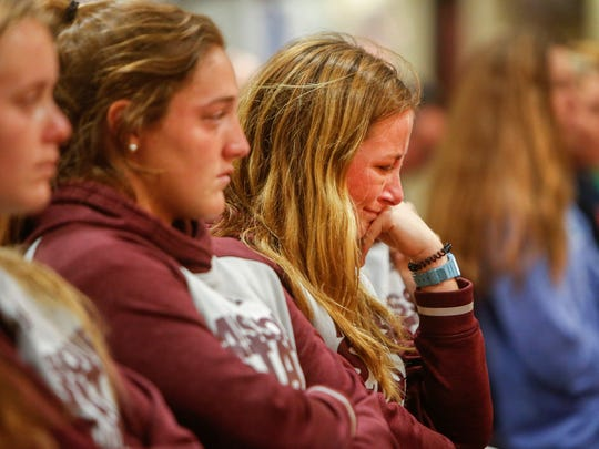 Anna Walmsley, a field hockey player at Missouri State University, reacts after it was announced that the program was eliminated due to budget cuts during a press conference at JQH Arena on Monday, April 3, 2017.