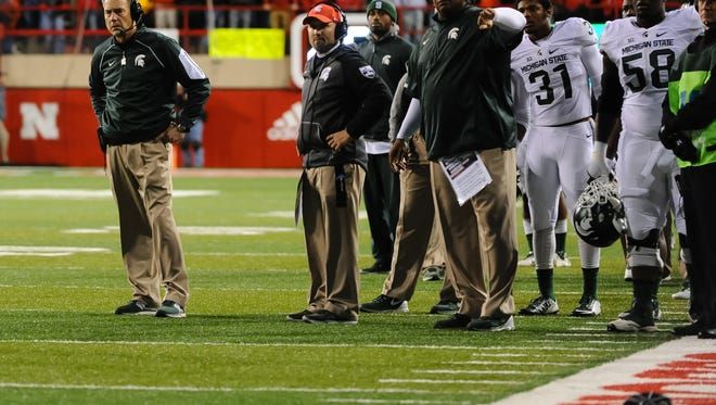 Michigan State Spartans head coach Mark Dantonio awaits a ruling on a controversial touchdown by Nebraska.It was ruled a TD, and the Cornhuskers won.
