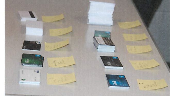 Stacks of credit cards were recovered during a routine traffic stop in Livonia last week. Many were blank, though police say 20 had fraudulent information attached to them.