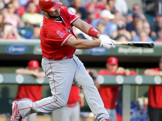 Los Angeles Angels Albert Pujols (5) follows through on a single during the fourth inning of a baseball game against the Minnesota Twins, Wednesday, July 5, 2017, in Minneapolis.