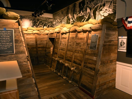 Visitors to the exhibit on Alvin York at the Museum of East Tennessee History can walk through a re-created trench built using barn wood topped with sandbags.