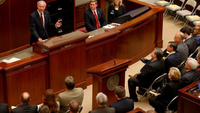 Gov. Asa Hutchinson addresses a joint session of the Legislature as the 90th General Assembly convenes for the first day of its third special session at the State Capitol in Little Rock, on Thursday, May 19.