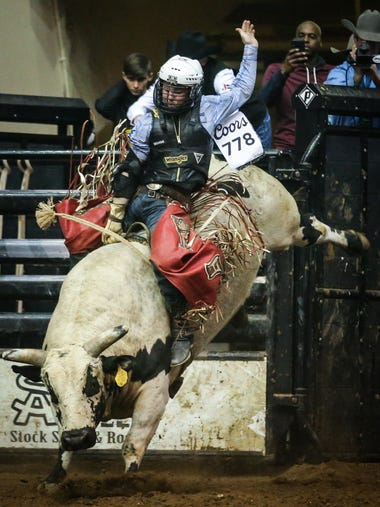 Trey Benton III rides a bull called Jay Z during the