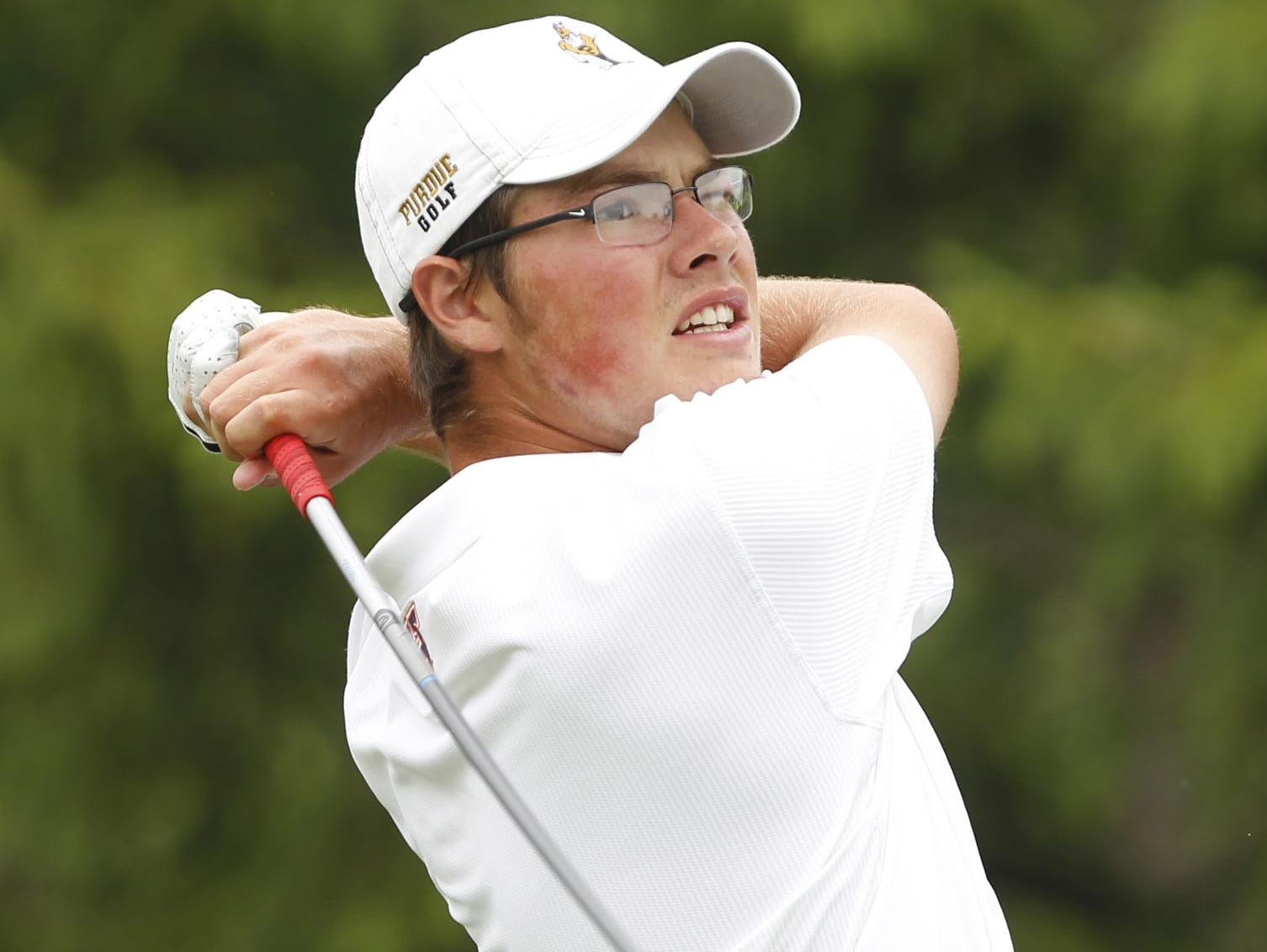 Harrison's Cole Bradley drives at the par 5 No. 15 in the boys golf Sectional Saturday, June 6, 2015, at Coyote Crossing in West Lafayette.
