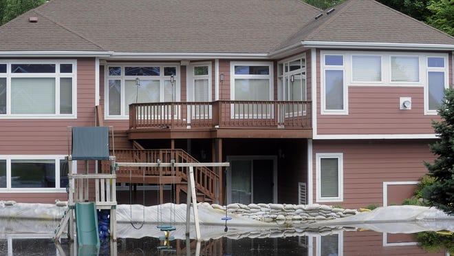 Water covers the front lawn of this house in Dakota Dunes Saturday, June 18, 2011.(Elisha Page/Argus Leader)
