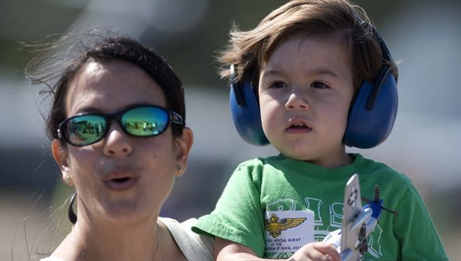 Patty Box and her 2-year-old son, Greyson, attend the Blue Angels practice behind the National Museum of Naval Aviation Tuesday morning March 17, 2015.