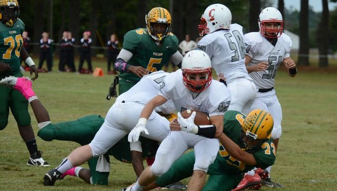 Broadwater Academy's Hayden Mabalot (73) tackles Isle of Wight's Alec Edwards during the Vikings' football game in Exmore Saturday, Oct. 10, 2015. Broadwater fell to the Chargers, 60-26.