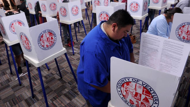 A voter is seen at the Oxnard Boys & Girls Club in this 2012 photo.