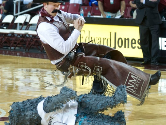 Pistol Pete lays the smackdown on a Lobos mascot before a 2015 game between the NMSU Aggies and the UNM Lobos at the Pan American Center in Las Cruces.