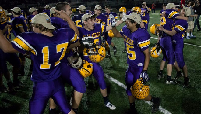 Blue Ridge celebrates its 17-7 win after the Division IV state championship game at North Canyon High School.