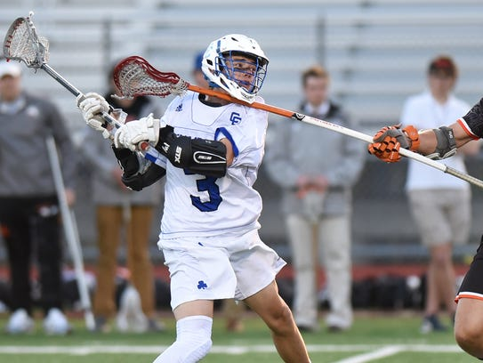 Even with the stick of Brother Rice's Carson Cochran