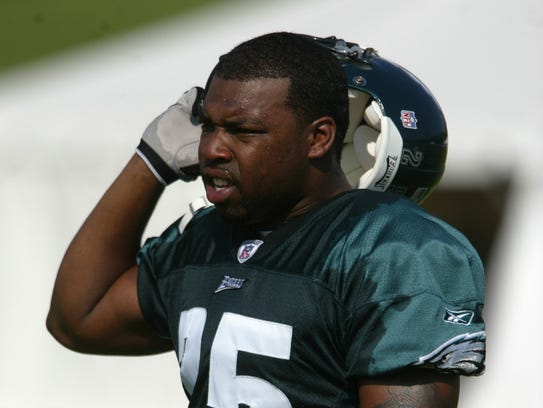 Eagles running back Eric McCoo of Red Bank watches