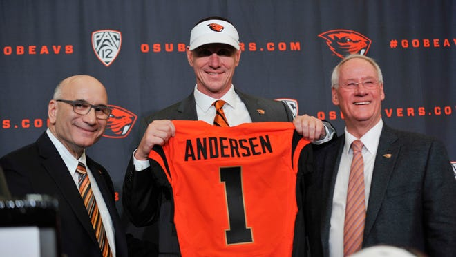 Oregon State athletics director Bob De Carolis, from left, joins football coach Gary Andersen and OSU President Edward Ray during a December news conference at Reser Stadium in Corvallis.