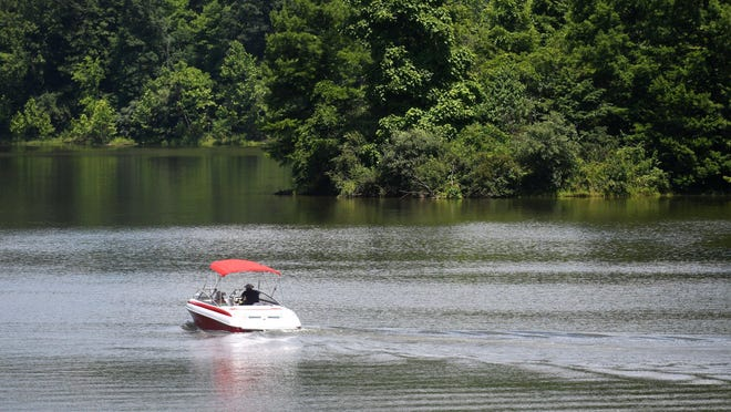 A boater on Salt Fork State Park Lake.  Tuesday, June 30, 2020.