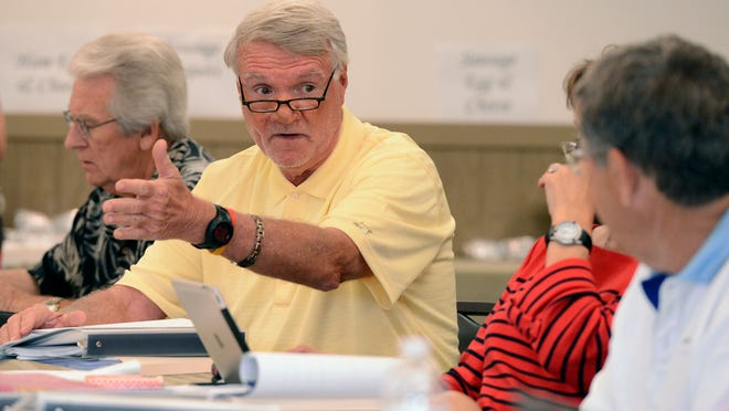 Arkansas Board of Corrections member Buddy Chadick discusses prison overcrowding during a meeting of the board Thursday at Norfork.