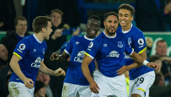Everton's Ashley Williams is congratulated by teammates after scoring the winning goal Arenal.