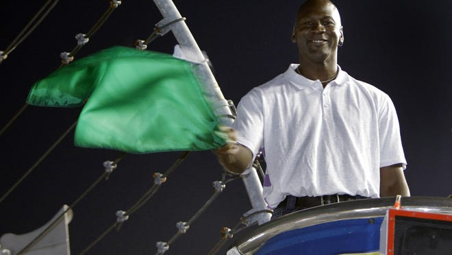 Charlotte Bobcats (now Hornets) owner Michael Jordan practices waving the green flag before the NASCAR All-Star auto race at Charlotte Motor Speedway in Concord, N.C., on May 22, 2010. Jordan was the honorary starter for the race.