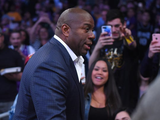 Apr 7, 2017; Los Angeles, CA, USA;  Magic Johnson, Los Angeles Lakers president for basketball operations acknowledges the fans as he attends the game against the Sacramento Kings at Staples Center. Lakers won 98-94. Mandatory Credit: Jayne Kamin-Oncea-USA TODAY Sports