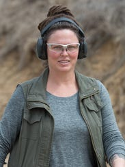 Kim Duko of Ellendale walks away from the shooting targets during an International Defensive Pistol Association match at the Bridgeville Rifle & Pistol Club. This variety of shooting match simulates self-defense scenarios and real-life encounters.