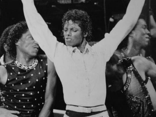 Michael Jackson performs at the Pontiac Silverdome on Aug. 18, 1984.