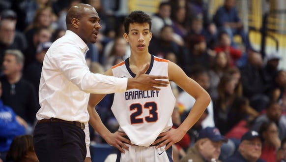 Briarcliff coach Cody Moffett talks to Miles Jones. Their team defeated Center Moriches 62-49 in the boys basketball Class B regional championship game at Pace University in Pleasantville March 10, 2018.