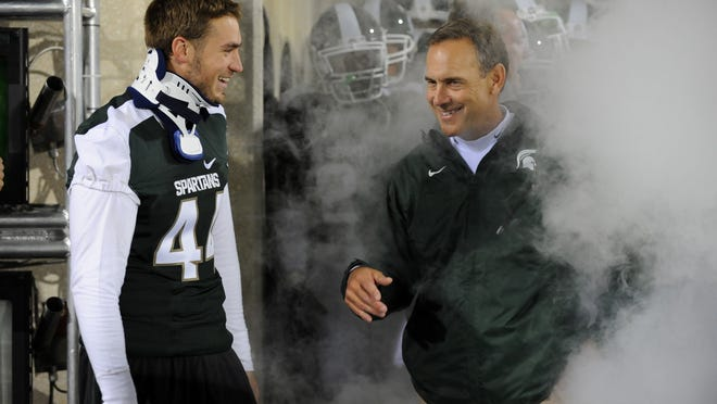 After Josh Rouse, left, suffered a neck injury in the first game of the 2010 season, MSU coach Mark Dantonio gave him a job as an assistant in the team's weight room. Rouse eventually served as a graduate assistant coach with the Spartans' offense in 2012.